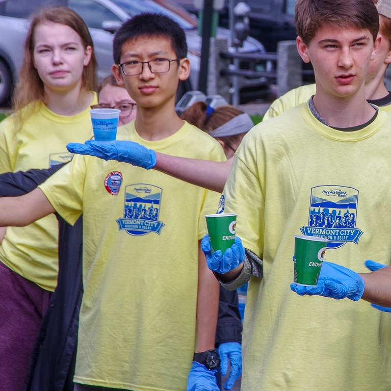 Volunteers passing out water at Vermont marathon